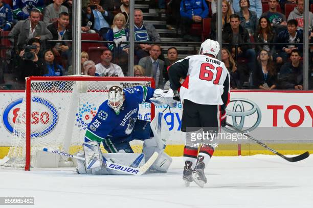Mark Stone of the Ottawa Senators scores on Jacob Markstrom of the Vancouver Canucks during the shootout of their NHL game at Rogers Arena October 10...