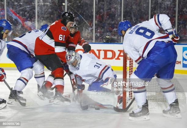 Mark Stone of the Ottawa Senators searches for a rebound against Carey Price of the Montreal Canadiens as Jordie Benn Charles Hudon and Bobby Ryan...