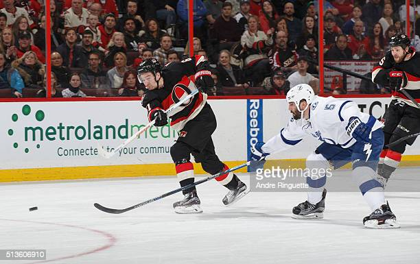 Mark Stone of the Ottawa Senators shoots the puck against Jason Garrison of the Tampa Bay Lightning at Canadian Tire Centre on March 3 2016 in Ottawa...