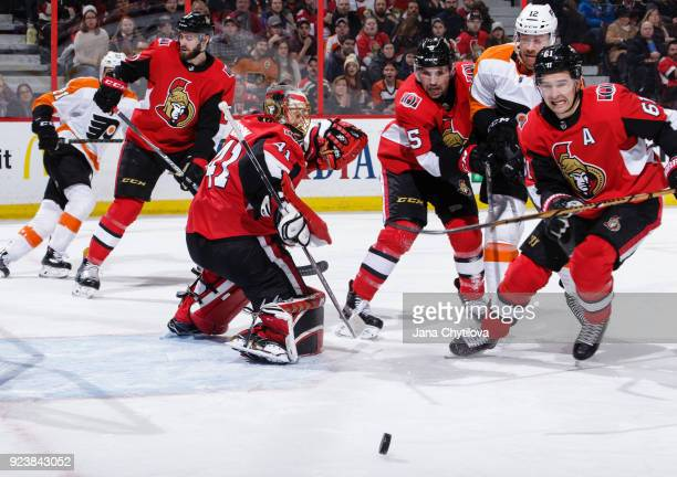 Mark Stone of the Ottawa Senators skates after the rebound on a save by teammate Craig Anderson Cody Ceci of the Ottawa Senators defends against...
