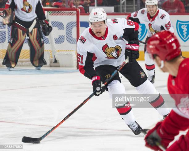 Mark Stone of the Ottawa Senators skates up ice with the puck during an NHL game against the Detroit Red Wings at Little Caesars Arena on December 14...