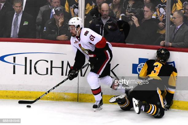 Mark Stone of the Ottawa Senators skates with the puck as Olli Maatta of the Pittsburgh Penguins hits the boards during the third period in Game...