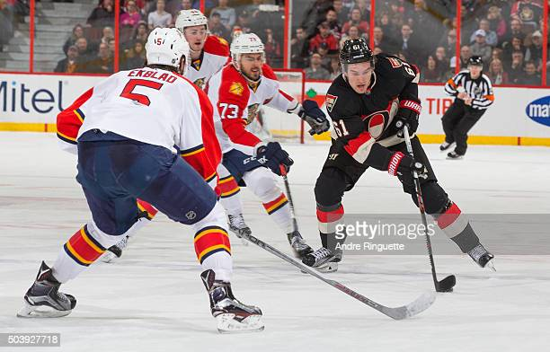 Mark Stone of the Ottawa Senators stickhandles the puck against Brandon Pirri and Aaron Ekblad of the Florida Panthers at Canadian Tire Centre on...
