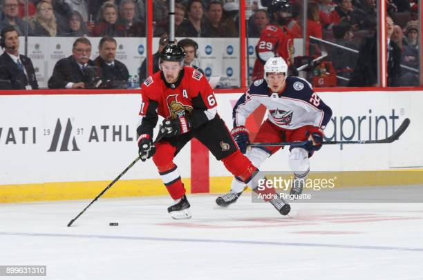 Mark Stone of the Ottawa Senators stickhandles the puck against Sonny Milano of the Columbus Blue Jackets at Canadian Tire Centre on December 29 2017...