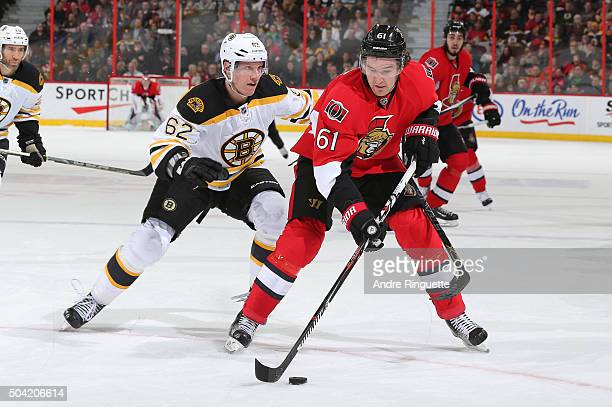 Mark Stone of the Ottawa Senators stickhandles the puck against Zach Trotman of the Boston Bruins at Canadian Tire Centre on January 9 2016 in Ottawa...