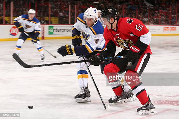Mark Stone of the Ottawa Senators turns towards the net with the puck against Carl Gunnarsson of the St Louis Blues at Canadian Tire Centre on...