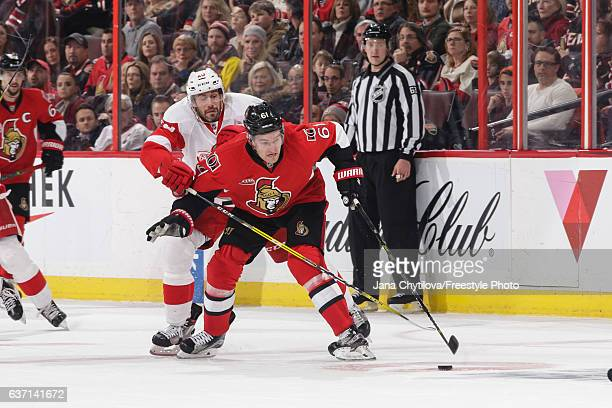 Mark Stone of the Ottawa Senators uses his body to protect the puck from Drew Miller of the Detroit Red Wings at Canadian Tire Centre on December 29...