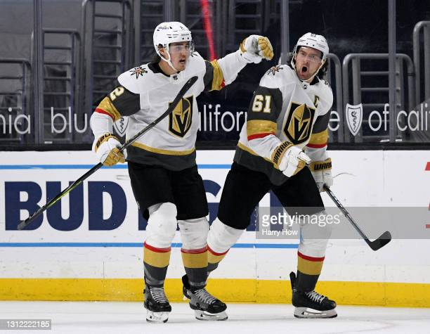 Mark Stone of the Vegas Golden Knights celebrates his goal with Zach Whitecloud, to tie the game 2-2 with the Los Angeles Kings, during the second...