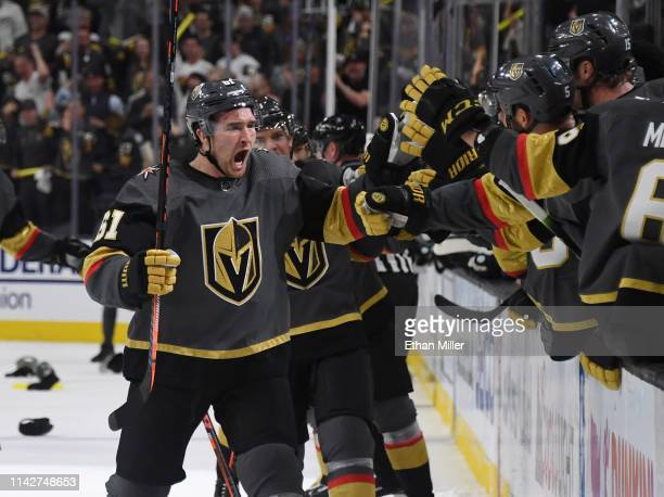 Mark Stone of the Vegas Golden Knights celebrates with teammates on the bench after scoring a thirdperiod goal his third goal of the game against the...
