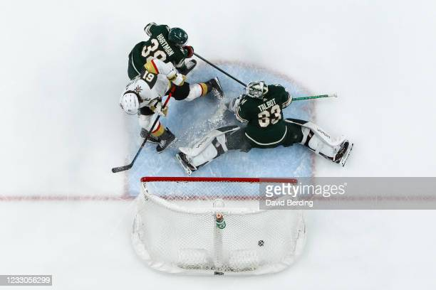 Mark Stone of the Vegas Golden Knights scores a shorthanded goal against Cam Talbot while Ryan Hartman of the Minnesota Wild defends in the second...