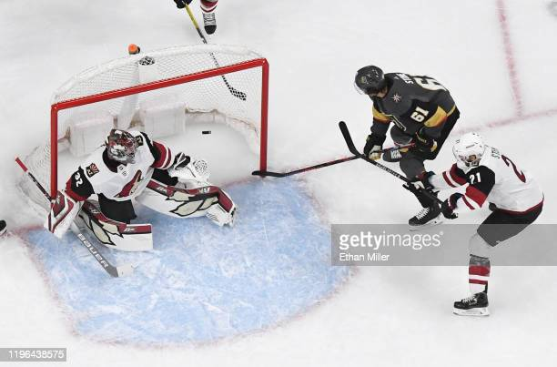 Mark Stone of the Vegas Golden Knights scores his second first-period goal against Antti Raanta of the Arizona Coyotes as Derek Stepan of the Coyotes...