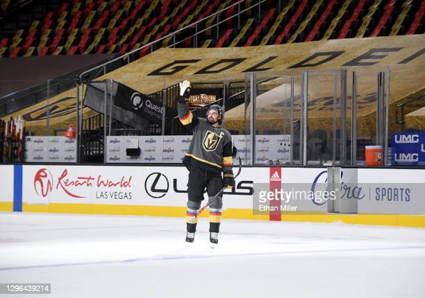 Mark Stone of the Vegas Golden Knights waves to an empty arena after being named the first star of the game following the team's 5-2 victory over the...