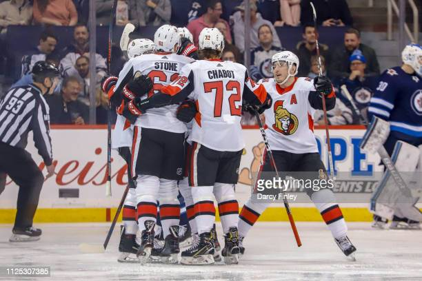 Mark Stone Thomas Chabot and Matt Duchene of the Ottawa Senators celebrate a first period goal against the Winnipeg Jets with teammates on the ice at...