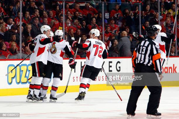 Mark Stone Thomas Chabot and teammates of the Ottawa Senators celebrate a goal against the Calgary Flames during an NHL game on October 13 2017 at...