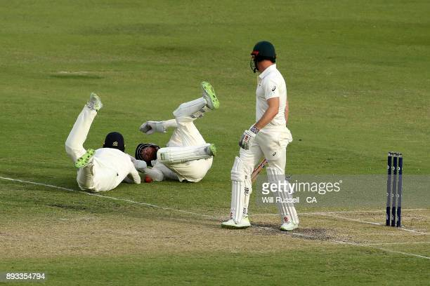 Mark Stoneman and Jonny Bairstow of England dive for a catch off Shaun Marsh of Australia during day two of the Third Test match during the 2017/18...