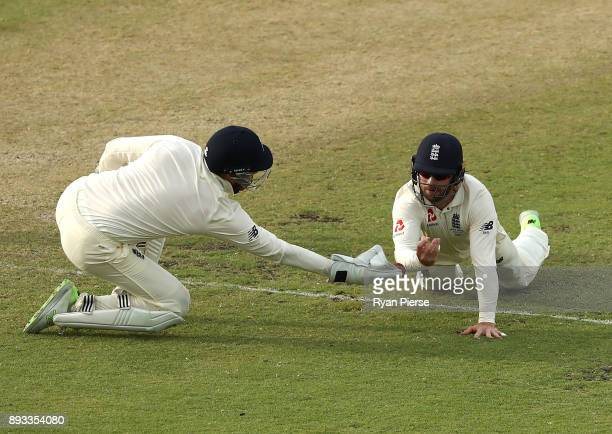 Mark Stoneman and Jonny Bairstow of England drop Shaun Marsh of Australia during day two of the Third Test match during the 2017/18 Ashes Series...