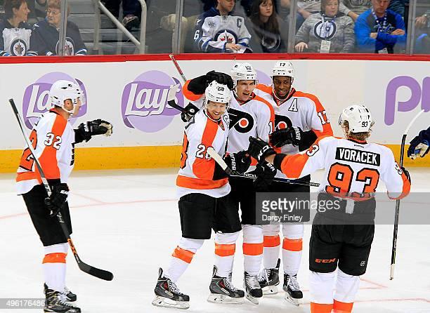 Mark Streit Claude Giroux Brayden Schenn Wayne Simmonds and Jakub Voracek of the Philadelphia Flyers celebrate a first period goal against the...