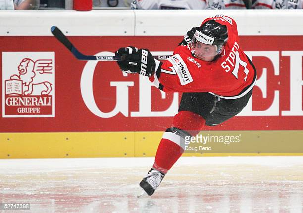 Mark Streit of Switzerland takes a slap shot against the Czech Republic in the IIHF World Men's Championships preliminary round group D game at...