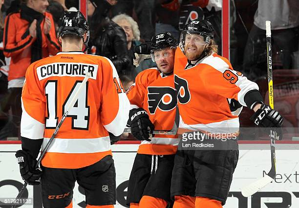 Mark Streit of the Philadelphia Flyers celebrates his second period goal against the Winnipeg Jets with teammates Sean Couturier and Jakub Voracek on...