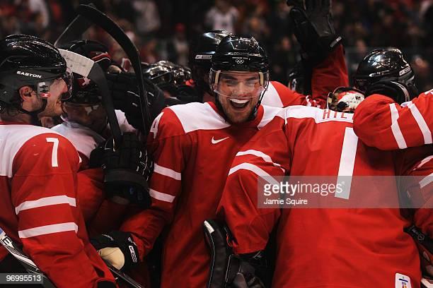 Mark Streit, Philippe Furrer and Jonas Hiller of Switzerland celebrate winning the ice hockey Men's Qualification Playoff game between Switzerland...