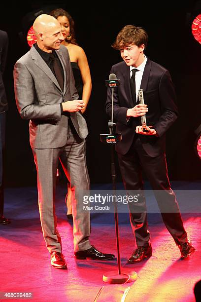 Mark Strong and Alex Lawther collect the Best Thriller award for The Imitation Game on stage during the Jameson Empire Awards 2015 at the Grosvenor...