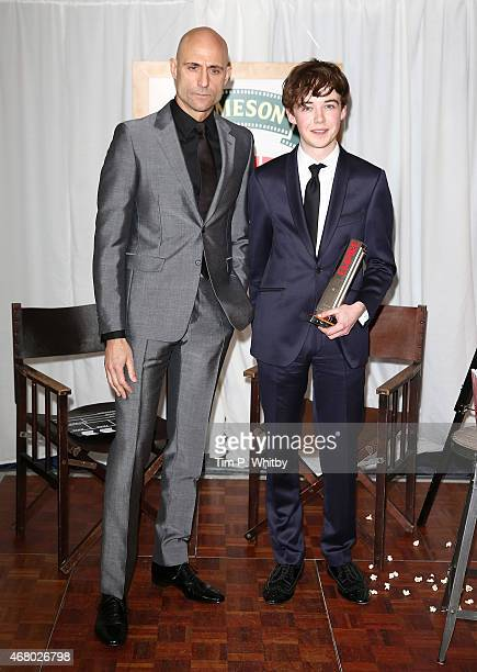 Mark Strong and Alex Lawther collect the Best Thriller Award for The Imitation Game during the Jameson Empire Awards 2015 at the Grosvenor House...