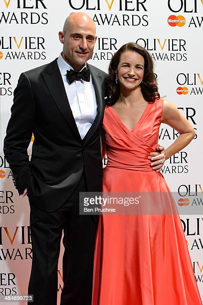 Mark Strong and Kristin Davis poses for photographers in the press room at the Laurence Olivier Awards at The Royal Opera House on April 13, 2014 in...