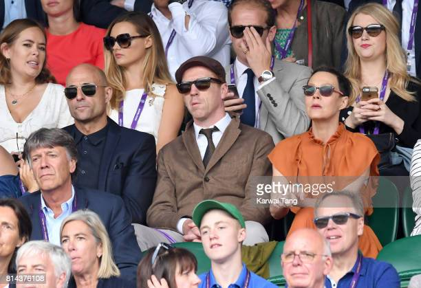 Mark Strong, Damian Lewis and Helen McCrory attend day 11 of Wimbledon 2017 on July 14, 2017 in London, England.