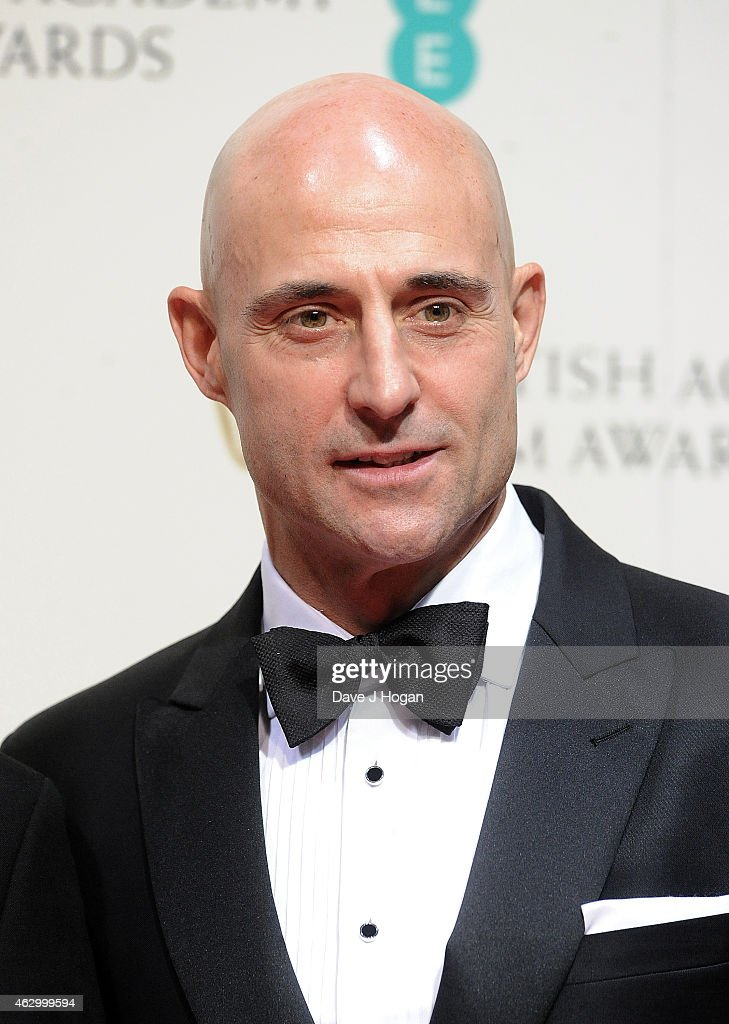 Mark Strong poses in the winners room at the EE British Academy Film Awards at The Royal Opera House on February 8, 2015 in London, England.