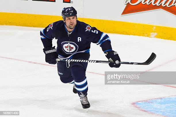 Mark Stuart of the Winnipeg Jets follows the play up the ice during first period action against the Toronto Maple Leafs at the MTS Centre on March 12...