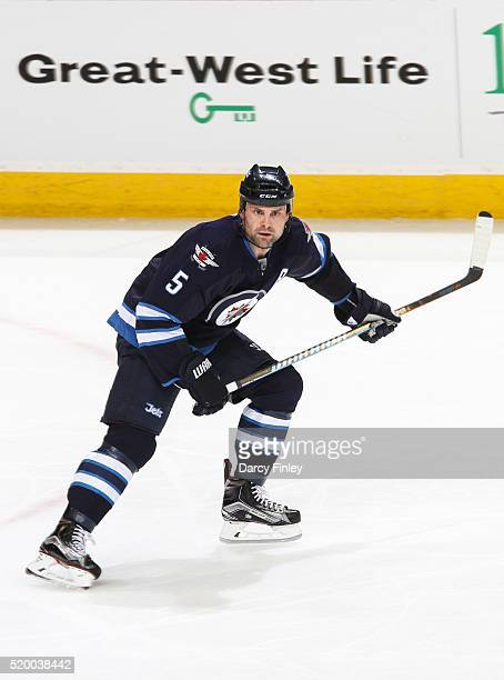 Mark Stuart of the Winnipeg Jets follows the play up the ice during second period action against the Minnesota Wild at the MTS Centre on April 3 2016...