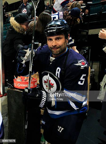 Mark Stuart of the Winnipeg Jets hits the ice for the pregame warm up prior to NHL action against the Arizona Coyotes at the MTS Centre on January 26...