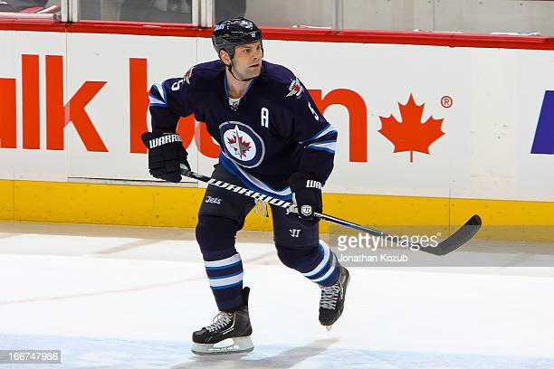 Mark Stuart of the Winnipeg Jets keeps an eye on the play during first period action against the Buffalo Sabres at the MTS Centre on April 9 2013 in...