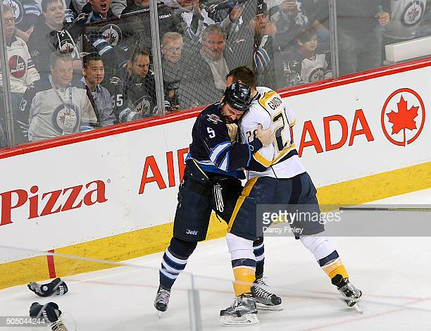 Mark Stuart of the Winnipeg Jets mixes it up with Paul Gaustad of the Nashville Predators during a second period fight at the MTS Centre on January...