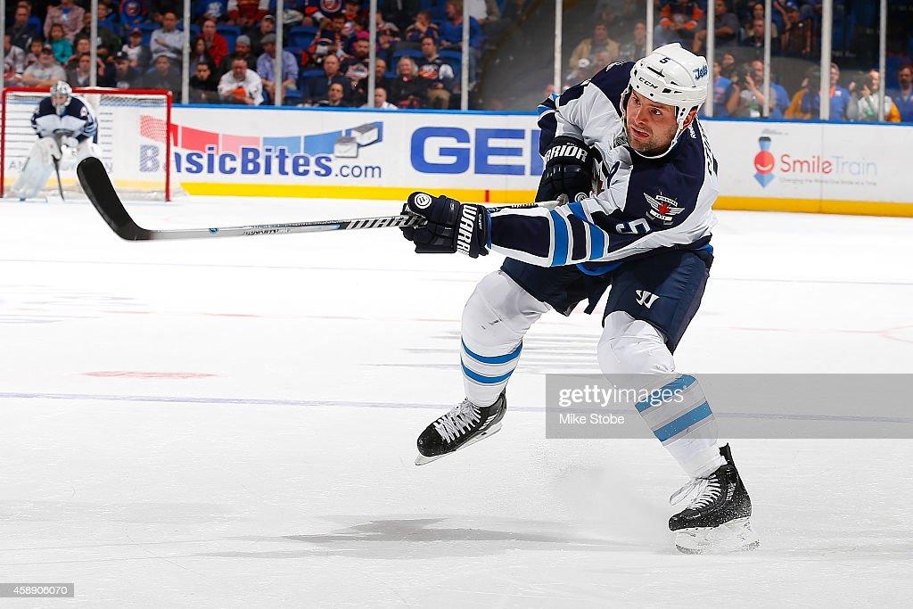 Mark Stuart #5 of the Winnipeg Jets skates against the New York Islanders at Nassau Veterans Memorial Coliseum on October 28, 2014 in Uniondale, New York. The Winnipeg Jets defeated the New York Islanders 4-3.