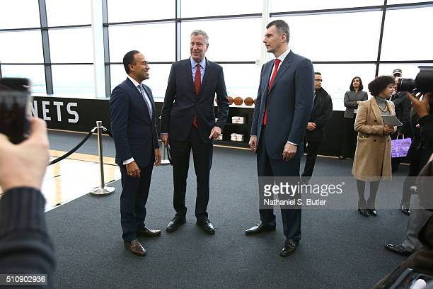 Mark Tatum Bill de Blasio and Mikhail Prokhorov talk during the Opening of the HSS Training Center for the Brooklyn Nets on February 17 2016 at the...