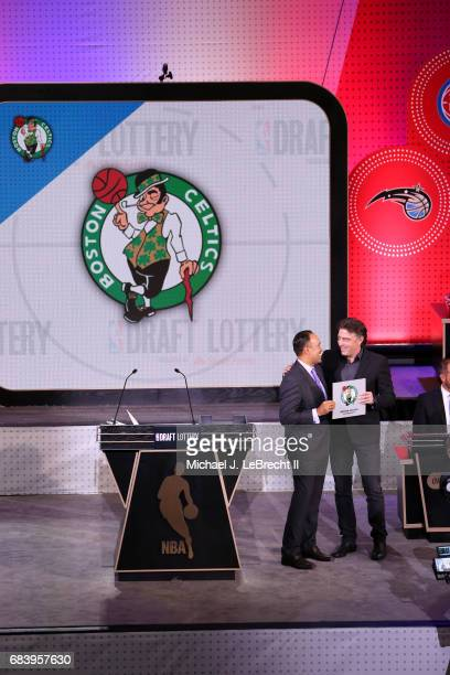 Mark Tatum Deputy Commissioner of the NBA presents the number 1 pick to the Boston Celtics during the 2017 NBA Draft Lottery at the New York Hilton...