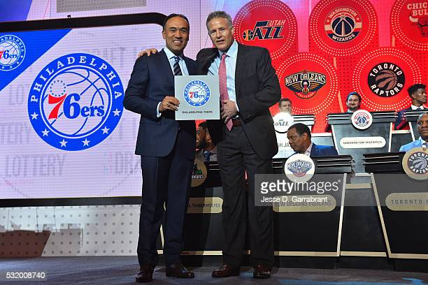 Mark Tatum NBA's deputy commissioner poses for a photo with Brett Brown of the Philadelphia 76ers as they get the pick during the 2016 NBA Draft...