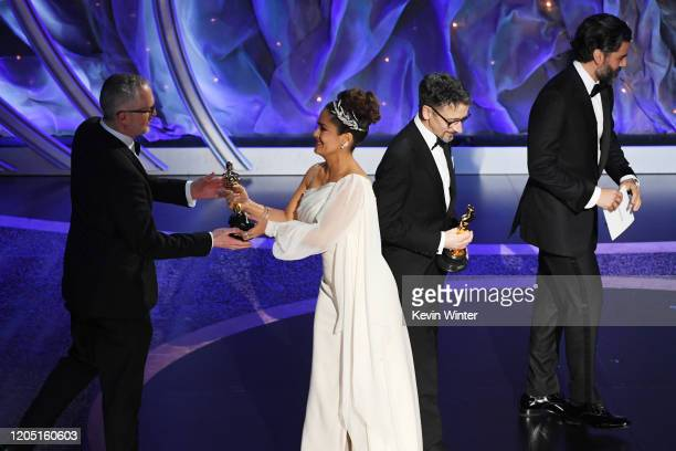 Mark Taylor and Stuart Wilson accept the Best Sound Mixing award for '1917' from Salma Hayek Pinault and Oscar Isaac onstage during the 92nd Annual...