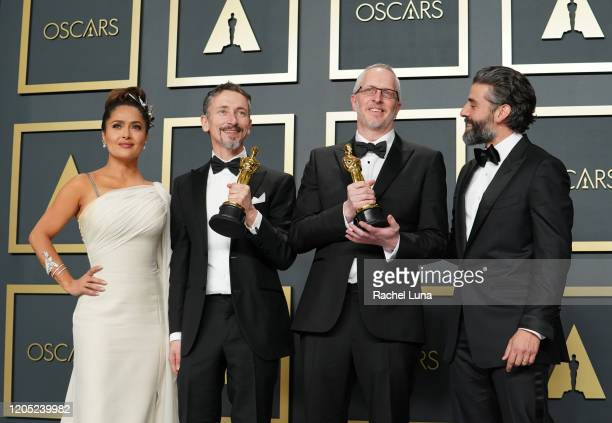 "Mark Taylor and Stuart Wilson, winners of the Sound Mixing award for ""1917,"" pose with Salma Hayek and Oscar Isaac in the press room during the 92nd..."