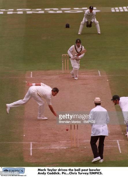 Mark Taylor drives the ball past bowler Andy Caddick
