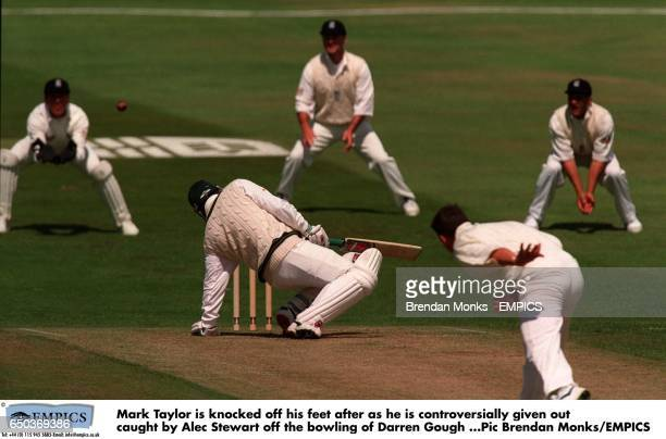 Mark Taylor is knocked off his feet after as he is controversially given ot caught by Alec Stewart off the bowling of Darren Gough