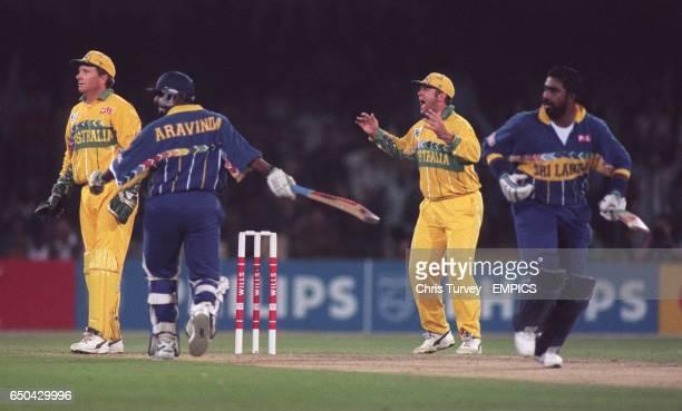 Mark Taylor of Australia can't believe it as Australia's Stuart Law drops a straightforward catch on the boundary from Asanka Gurusinha of Sri Lanka