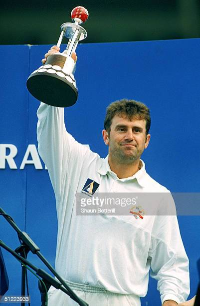 Mark Taylor of Australia holds aloft the Frank Worrell Trophy after the teams victory during the 5th Test Match between the Australia and the West...