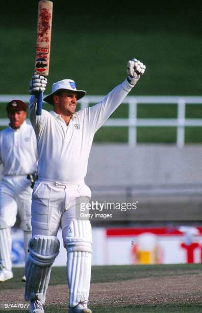 Mark Taylor of New South Wales celebrates reaching his double century in a Sheffield Shield match against Queensland on March 25 1990