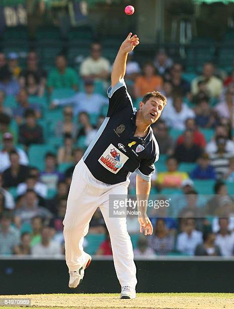 Mark Taylor of Taylor's XI bowls during the Australia's Big Bash Twenty20 Victorian Bushfire Appeal charity match at the Sydney Cricket Ground on...