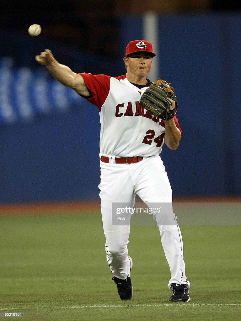 Mark Teahen #24 of Canada throws to first base for the out against Italy during the 2009 World Baseball Classic Pool C match on March 9, 2009 at the Rogers Centre in Toronto, Ontario, Canada.