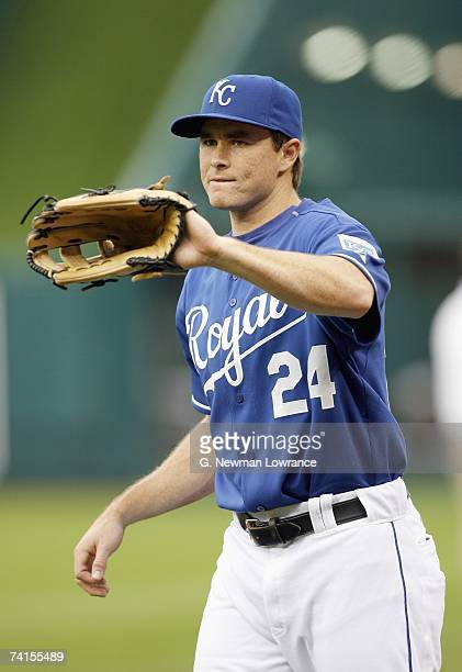 Mark Teahen of the Kansas City Royals look for the catch during practice against the Detroit Tigers at Kauffman Stadium on May 6 2007 in Kansas City...