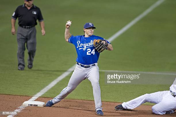 Mark Teahen of the Kansas City Royals turns a double play at third base against the Minnesota Twins at the Humphrey Metrodome in Minneapolis,...
