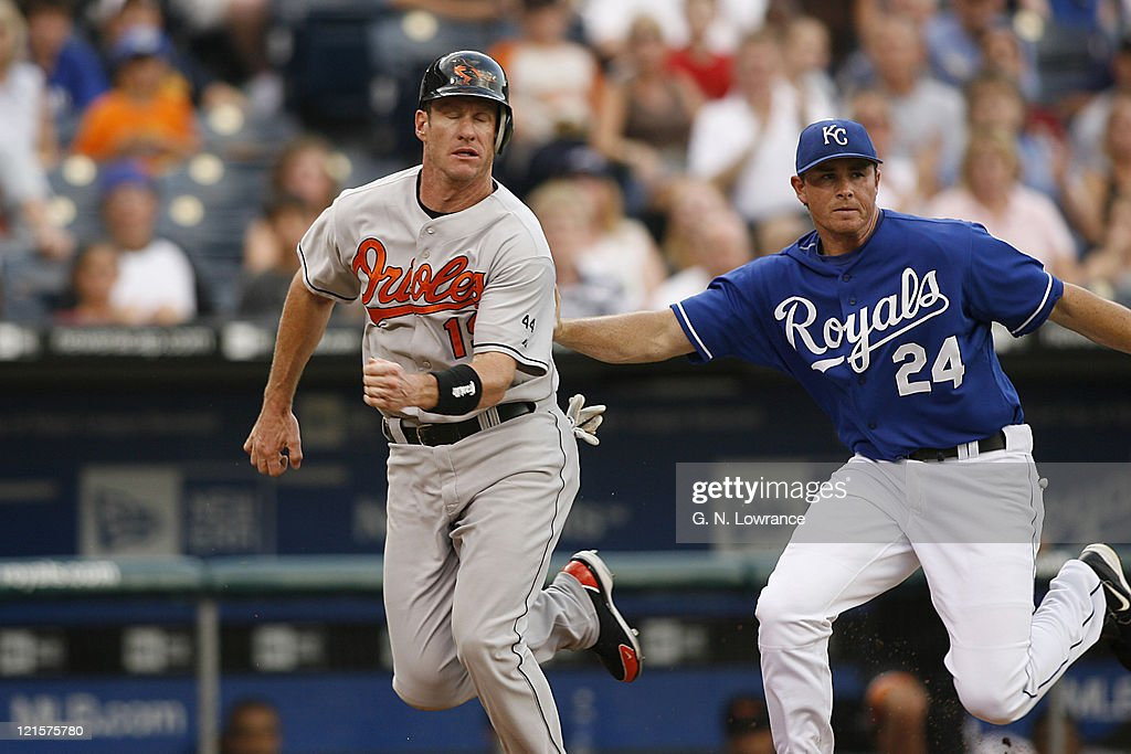 Mark Teahen of the Royals gets Jeff Conine during a run down in action between the Baltimore Orioles and Kansas City Royals at Kauffman Stadium in Kansas City, Missouri on July 26, 2006. Baltimore won 4-3.